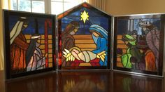 Stained Glass Nativity Trip Tych Beautiful addition to your holiday decor  Constructed in the Tiffany Method with a large variety of glass. It is hinged with a drop in rod between the three panels so that it can be separated into 3 pieces for storage.  This is a stand alone piece with each side panel measuring 10 1/2 inches wide by 12 1/2 high , the middle panel is 12 1/2 inches wide and 15 1/2 inches at its center peak.  Pictures just do not do this truly beautiful Nativity justice