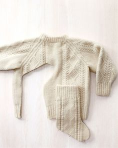 A shrunken sweater feels like felted wool -- thick and dense. This is a family-heirloom-worthy use for an outgrown Irish knit sweater (or one that accidentally found its way into the washer and dryer)...