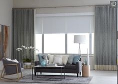 Layer large windows with simple shades and add texture with printed draperies.