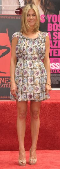 Who made Jennifer Aniston's nude pumps and print ruffle dress that she wore in Hollywood on July 7, 2011?