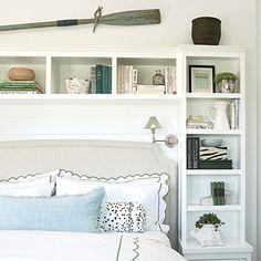 Built-in shelving in the master bedroom turns bedside storage into a custom design element. CoastalLiving.com