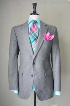 Speckled Tweed Suit, madras patterned tie, turquoise shirt, hot pink pocket square, outstanding flair.