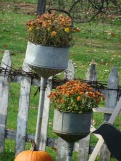 big metal funnels re-purposed into planters