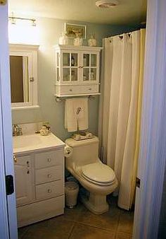 Small Bathroom design idea. White Vanity and cabinets. Shower curtains. Very clean and simple, and not all that far off from the vision in my head of ours.