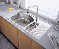 American Standard 7510 103 075 Culinaire Top Mount Dual Level Kitchen Sink With Drain Board