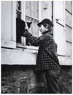 Robert Doisneau -Boy with Cat (1955)