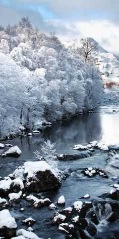 The Claunie river in Winter after a snow fall.   Travel to Scotland and see 28 mind blowing photos of this beautiful country!  Scottish Highlands | Edinburgh | Glasgow | Castles | Isle of Skye