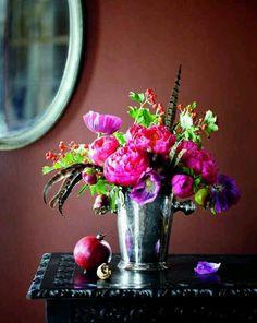 Flower arrangement in a vintage ice bucket (via One Kings Lane)