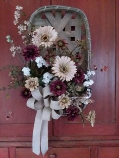 This is a spring/summer wall hanging that also goes into fall. Neutral and subdued colored flowers blends well with the tobacco basket. Available on my FB page, DCM Floral Designs.