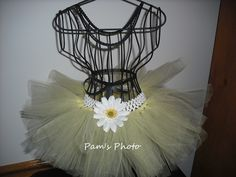 """13"""" inch White crochet elastic waste band. Light yellow and tulle is 6"""" inches in length. Decorated with a white flower on waste band."""