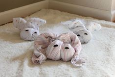 Great baby shower gift idea. Turn muslin swaddle blankets into a family of bunnies. From Baby Rabies.com.