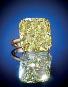An impressive 51.06 carats, VS1 clarity cut-cornered square modified brilliant-cut fancy intense yellow diamond ring