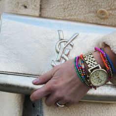 boyfriend chronograph looks great against the metallic bag and pop of the beaded bracelets.