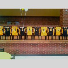 Cute idea for banquet. Use baseball jerseys instead on backs of chairs.