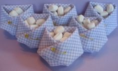 In case you would like the baby shower favor ideas that are homemade you should think about creating a 'diaper' of a napkin (make sure that you don't forget about the safety pin). Fill the diaper with colorful candy (that all the guests will love).