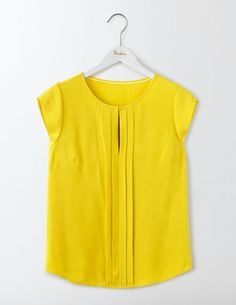 Turn heads wherever you go in this versatile top. Created from drapey viscose crepe, this style has pretty pleats down the front. Fasten the hook and eye for a clean round neck or wear loose for a soft V-neck shape.