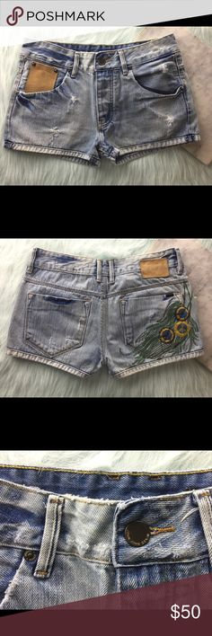"""John John High Waist Boho Feather Blue Jean Shorts John John Embroidered Feather High Waist Distressed MOM Boho Jean Shorts 6/8  - Condition: New without tags Retail: $125 John John is a premium, Brazilian denim line known for its high-quality and attention to interesting design details  Size 38 = Size 6/8 in US - please see measurements below to compare to your own clothing  Approximate measurements taken flat: Waist: 16"""" Rise: 10"""" Inseam: 2.5"""" John John Shorts Jean Shorts"""