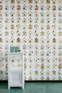 Birdhouse Wallpaper is filled with sweet birdhouses and elegant little birds on a worn-out background. Fabrics from the remnant basket, newspaper clippings, and cheerful prints provide a decoration for your wall.
