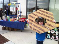 Girl Scout Cookie booth - Caramel deLite made out of cardboard, glue & shredded paper. DIY wins again!