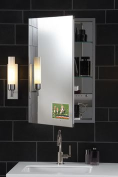 Stay plugged in while you groom via the M Series modular cabinet with TViD. Thanks to an 8-inch widescreen LCD television integrated in the mirrored door,