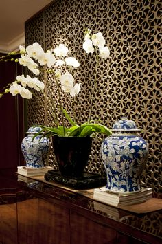 Wonderful accent wall with Asian-inspired / lotus motif. Iron? Bronze?