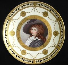 """Extremely RARE Pure White ~ 19th century ~ Porcelain plate ~ Made by Mintons for Tiffany & Co. ~ Artist signed F.N. Sutton ~ Portrait plate featuring """"Almeria"""" ~ originally painted by noted portrait artist John Opie ~ Plate is adorn with thick gold ~ Foil like circle around the portrait ~ Addition thick ~ gold medallions and garlands surround the border ~ There is a bit of Greek revival in the reticulated rim decoration with gold medallions"""