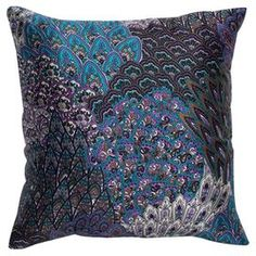 "Cotton pillow with a Peacock feather-inspired motif. Product: PillowConstruction Material: Cotton fabric and polyester fillColor: Blue, purple and blackFeatures: Multi-colored printed detailsHidden zipper enclosureMade in IndiaInsert includedDimensions: 18"" x 18""Cleaning and Care: Spot clean"