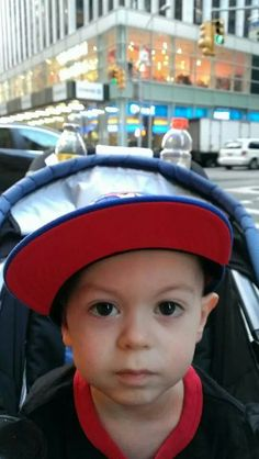 HINES SORE FROM SURGERY BUT STILL READY TO GO THEY WERE TAKING A WALK AND STOPPING AT FAO SWARTZ LOVE HIS EXPRESSIONS