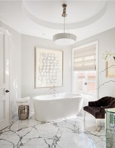 (Inspiration) Foamandbubbles.com: Even a very minimal modern bathroom can be given a glamorous edge with marble floors.