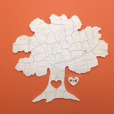 Modern version of a traditional wedding guest book. Bella Puzzles™. Frame it later on any background to match your home decor. Fun way to remember your wedding day. http://bella-puzzles.myshopify.com/collections/frontpage/products/tree-puzzle-guestbook-10-pieces