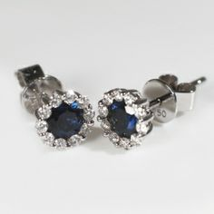 Stud Earrings With Sapphires and Diamonds  A pair of beautiful sapphire and diamond stud earrings in 18ct white gold. Total weight of sapphires 0.80ct and total weight of diamonds 0.25ct.