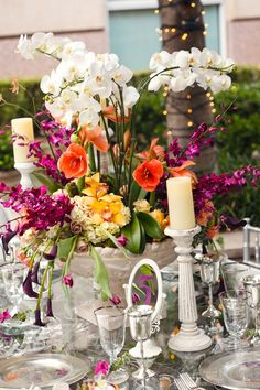 Whimsical and bright orchid and tulip table arrangement.   Photo by Bludoor Studios.  #wedding #tabletops