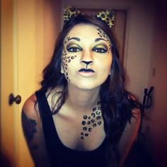 Women\'s medium length half shaved hairstyle. Leopard hair. Leopard ...