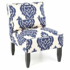 """The perfect addition to your master suite ensemble or living room seating group, this lovely pine wood-framed accent chair showcases a cosmopolitan damask motif and foam cushioning. Handmade in the USA.   Product: Chair  Construction Material:  Pine wood, metal, foam and cotton   Color: Blue and cream    Features: Damask motifPillow includedHandmade in the USA      Dimensions: 33"""" H x 25"""" W x 32"""" D  Assembly: Assembly required - hardware and instructions included"""