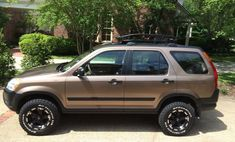 Lifted Honda CRV Baja style with Thule Canyon roof rack