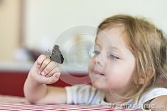 Little girl holds on the hand the Aglais io butterfly and watches for him, observation
