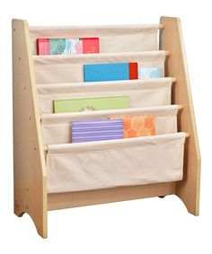 Perfectly sized for little ones to reach, this sling bookshelf features canvas shelves that hang in a neat row and keep books from getting damaged or lost. It's laid out so that books can be stored with their colorful covers on display.