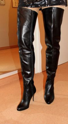 Black thigh boots modeled by amateur