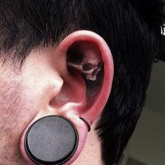 Rad ear tattoo by Jak Connolly...