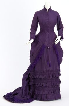 Royal purple silk taffeta bustled dress. Wedding dress of Anna Malcolm Agnew Davis (Mrs. Cushman K. Davis), attributed to the Christianson sisters, dressmakers of Minneapolis, Minnesota.