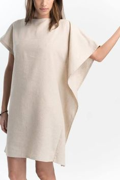 The loose and oversized tunic dress gently drapes over the left shoulder with its unique one-side wing. Loose, carefree, made of premium linen, the dress is short and could also be worn as a tunic with your favorite leggings. Minimalism with an edge. Linen Tunic Dress, Linen Dresses, Casual Dresses, Women's Swimsuits & Cover Ups, Quoi Porter, Patchwork Dress, Fashion Outfits, Couture, Clothes For Women