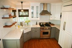 green lower cabinets, two tone cabinets, subway tile, wood shelves