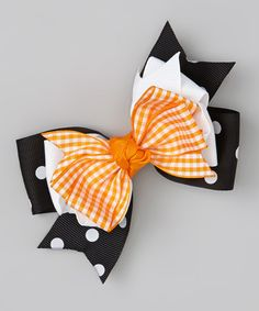 Take a look at this Orange Gingham & Black Polka Dot Bow Clip by Jumping Giraffes on #zulily today!