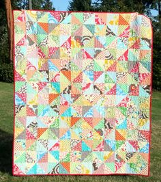 """I started by cutting 6"""" squares and used this method to make them into the 5 1/2"""" finished blocks. There are 168 blocks, 12 across & 14 down, making it 60"""" x 70"""""""