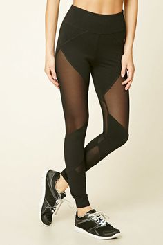 A pair of knit cotton-blend leggings featuring geo-shaped mesh paneling down the sides and an elasticized waist.