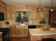 DARKER COUNTER TOPS LOOK GOOD, I JUST DONu0027T LIKE THE ONES SHOWN HERE. hickory  kitchen cabinets - Google Search