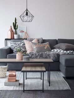 Modern living room in grey with copper and pink accents. Geometric diamond pendant lamp. #home