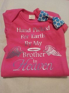 "I got one of these in pink and black for our new baby girl. Says ""sister"" instead of brother. Love the matching headband."