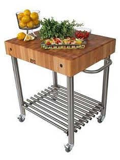 Prep for your parties in ease with the Prep Cart with Butcher Block Top; equally handsome and functional.