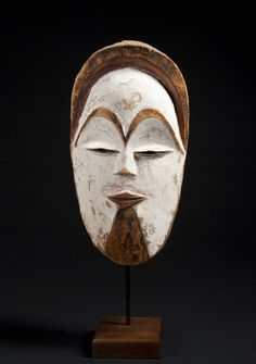 Of classical form, finely carved with remains of black pigment on the hairline, brow, and chin. Remaining red and white pigment throughout. African Dolls, African Masks, Art Premier, Black Pigment, Art Sculpture, Africa Art, Masks Art, Tribal Art, Carving
